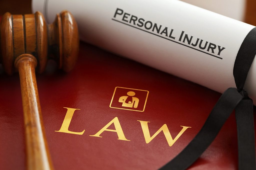 Personal injury attorney contract, book, and gavel
