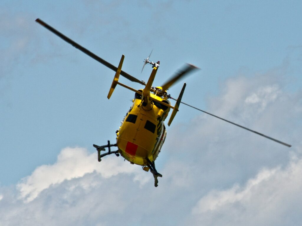Yellow helicopter in air