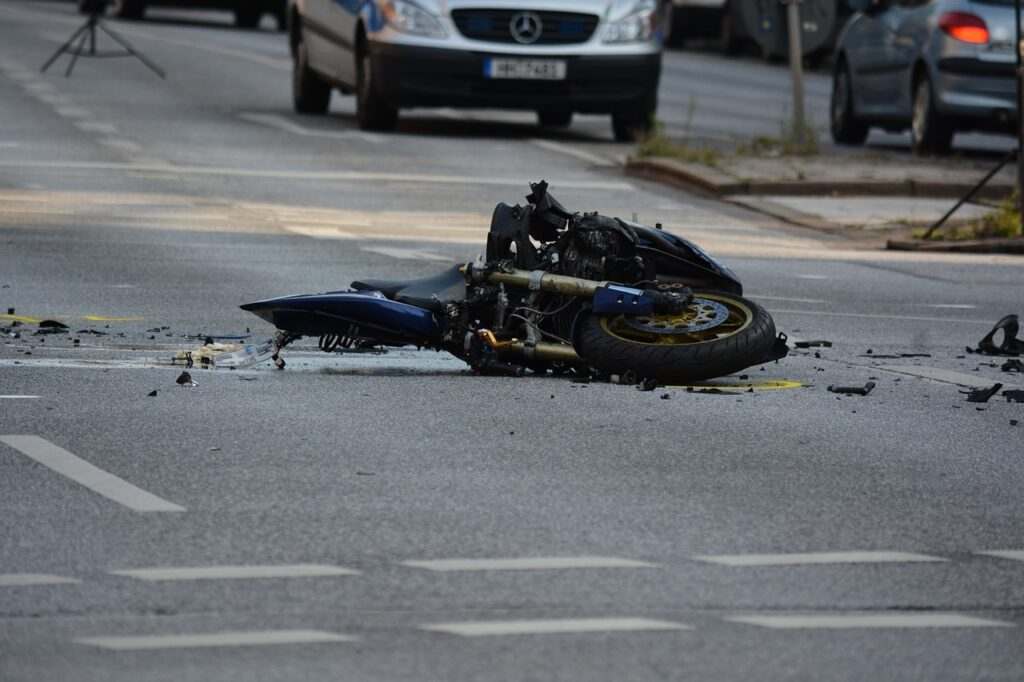 Motorcycle Accident in Middle of Street