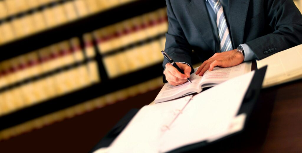 Lawyer writing notes on table